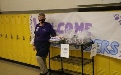 Mrs. Dianna Bowcock gets ready to hand out breakfast snacks to students. Students get free breakfast and lunch everyday this school year.