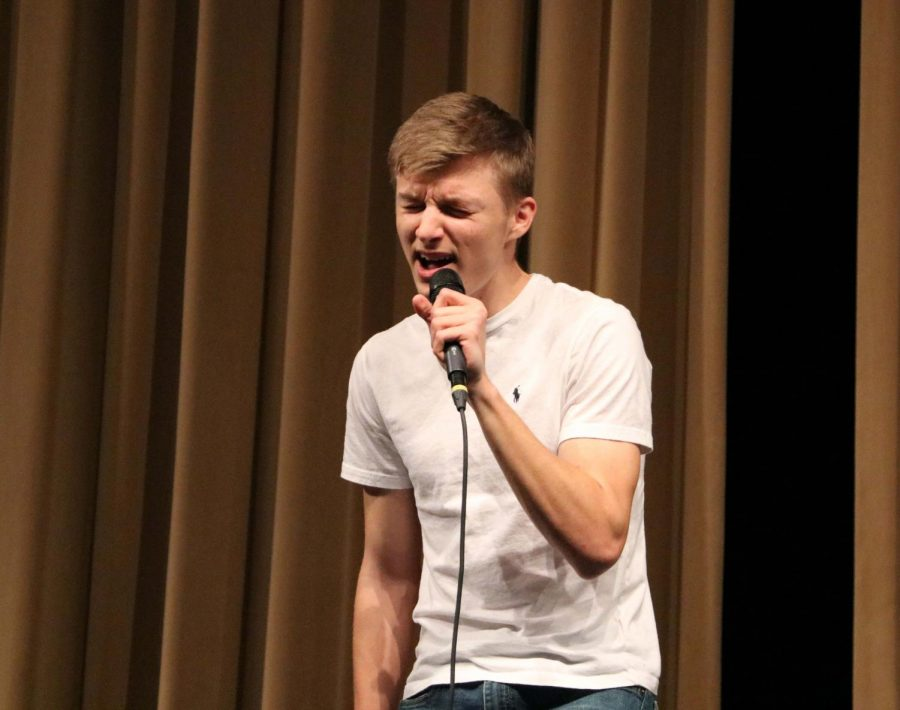 "After singing the song ""Loud and Heavy,"" Gavin Sandvoss (11) was the winner in the high school competition."
