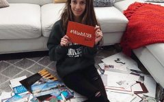 Melisa Vilic  (12) sitting amongst her many acceptance letters. She will be going to WashU on a full ride scholarship.