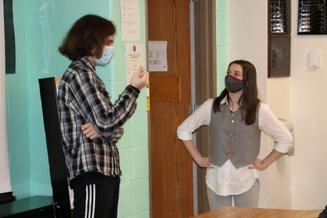 Mitch Aschenbrenner  (11) and Carlie Dobbins (11) practice their Duo Interpretation presentation before their competition.