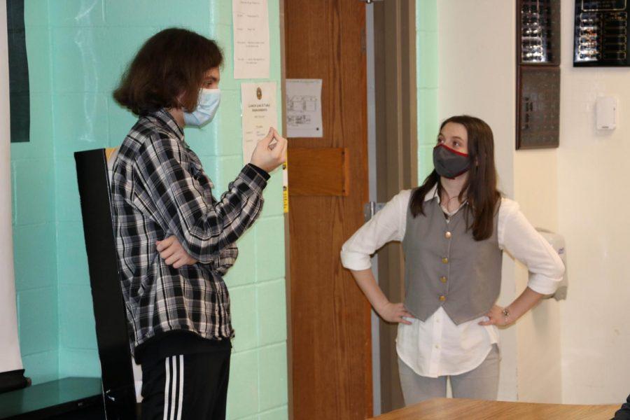Mitch Aschenbrenner  (11) and Carlie Dobbins (11) practice their Duo Interpretation presentation before their competition.