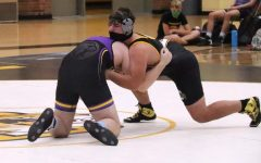 Ethan Venable (9) taking down his opponent during a match against Brentwood.