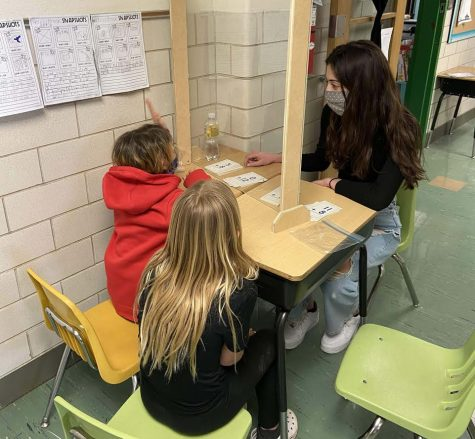 Leyla Vilic (11) tutoring younger students at Wohlwend Elementary. Many A+ tutors have struggled to get their hours in this year with COVID-19 restrictions.