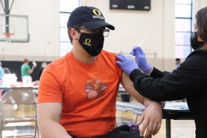 OHS Science teacher Daniel Wrangler gets his first Moderna vaccination shot at OHS' vaccination event