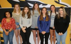 Seven journalism students earn national recognition from the JEA competition. Front row: Avery Neal (12), Layla Halilbasic (10), Eva Bidle (11), and Lejla Pozegic (10). Back row: Cassandra Ludwig (12), Meg Heveroh (12), and Jojo LaBrier (12)