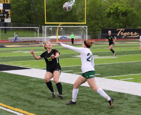 Katie Leeker (12) goes to head butt the ball during her senior night game against Marquette on May,11. Unfortunately the Tigers fell short to the Mustangs 2-1.