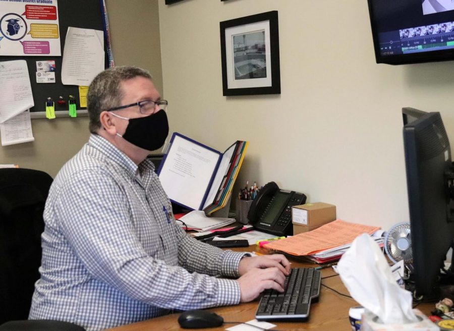 Mr. Brian Brennan spends a lot of his time working on contact tracing to keep the school safe.