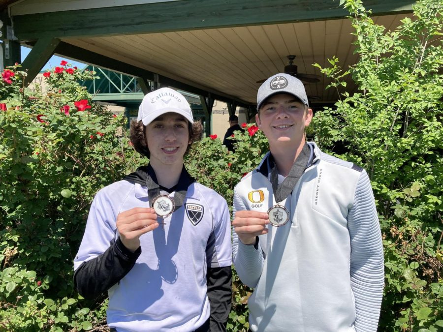 Nick Nava (11) and Colby Noblitt (10) show off their medals from the conference tournament on May 5.