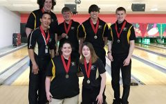 The bowling team took first place in the  Annual Mid-American High School Tournament on April 24.