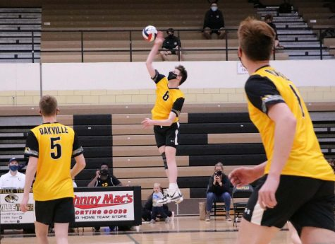 Ethan Walters (11) goes up for the hit during a game.
