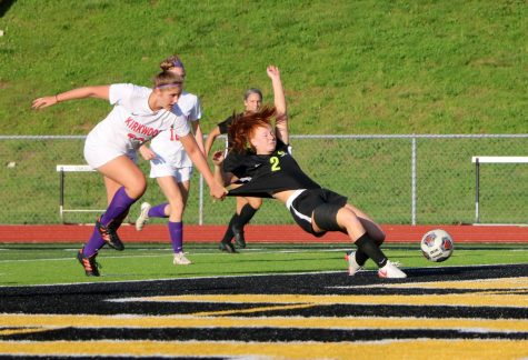 Mackenzie Deutschmann being pulled down in a 3-1 win over Kirkwood. Deutschmann leads the 12-2 Tigers with 15 goals.