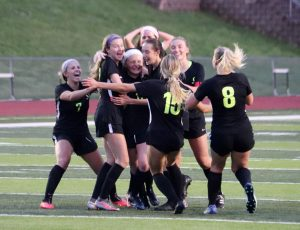 OHS Girls soccer celebrates with Paige Lurkins (11) after scoring the game winning goal against Eureka in overtime on May 4. The 1-0 win over Eureka advances their winning streak to 11 games.