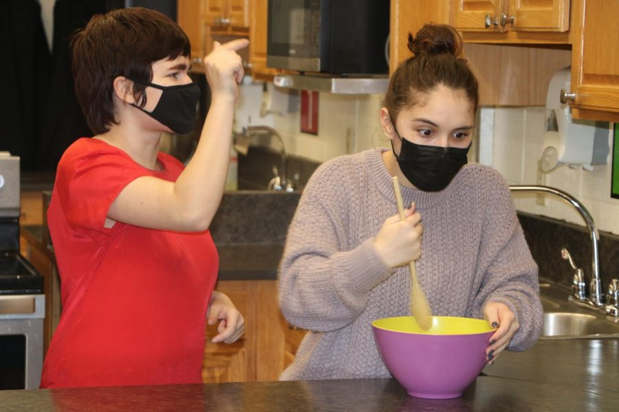 """Sam Girard (10) and Olivia Lutker (11) practice their play entitled """"American Gladiator Housewives,"""" for the second virtural play"""