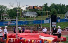 Mason Meinershagen (10) pole vaults at state track meet.